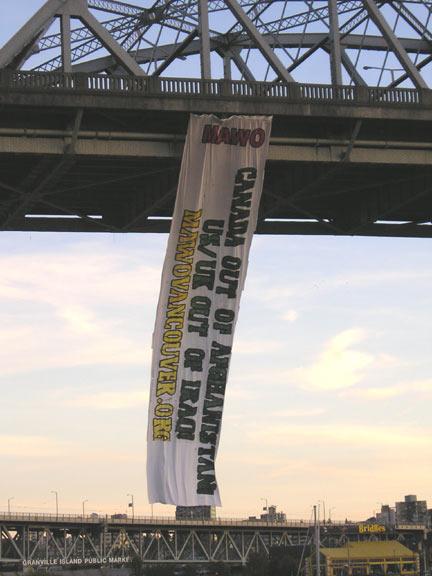 100 foot Antiwar Banner dropped from Burrard Bridge on September 24
